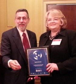 Rabbi Genack and Sandra Sorenson, Global Procurement Manager of ADM
