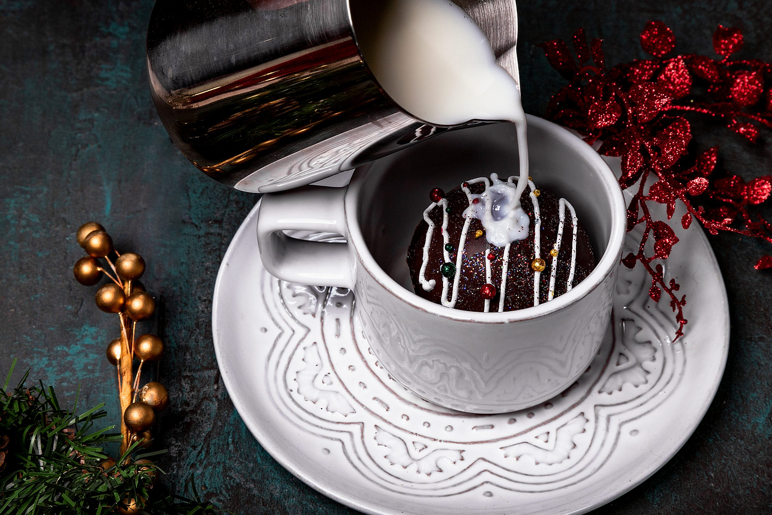 Hot Milk Being Poured Over A Hot Cocoa Bomb