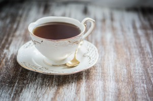 OU KOSHERBEHIND THE UNION SYMBOL- CUP OF TEA ON WOODEN BACKGROUND