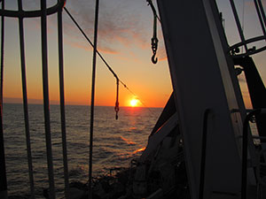 SUNSET OFF THE STARBOARD BOW OF THE OCEAN ROVER.